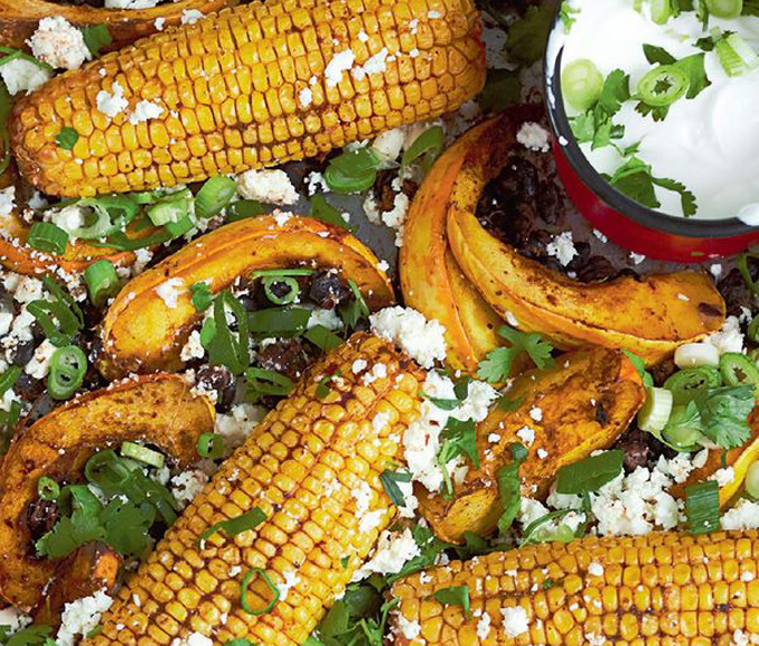 Chipotle-roasted sweetcorn with squash, black beans, feta & lime